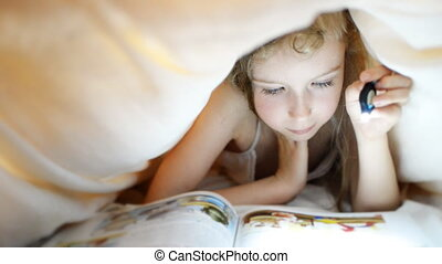 Little girl reading book. - Little girl reading book under...