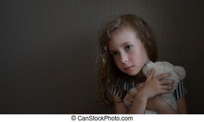 Sad little girl with bear - Sad little girl with bear near...