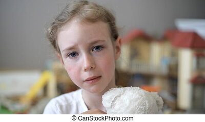 Crying little girl. - Crying little girl with bear in the...