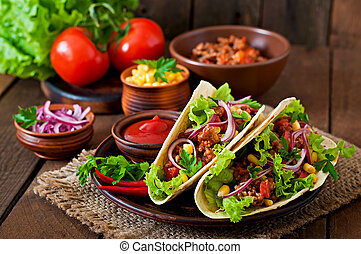 Mexican tacos with meat, vegetables and red onion