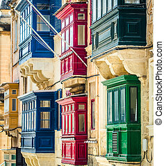 street with balconies in Valletta - traditional balconies in...