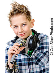 pop singer - Cheerful teen boy listening to music in...