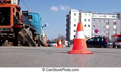 Traffic cone redirect city traffic - Traffic cone lined on...
