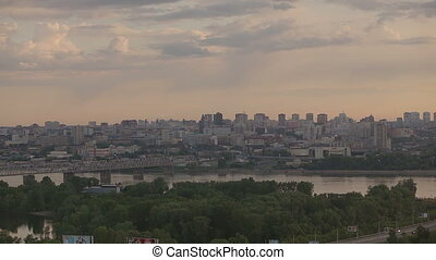 City Panorama in the sunrise - Bridge over river Ob in the...