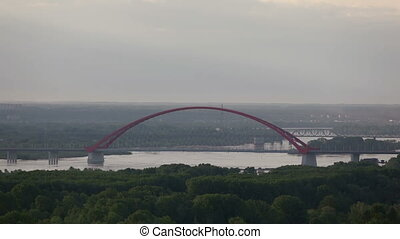 Red Bridge in the summer sunrise - Red Bridge over river Ob...