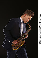 Saxophonist - Professional jazz musician playing saxophone...