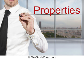 businessman writing properties in the air office -...
