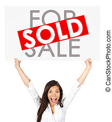 Real estate woman holding sold sign - Young successful mixed...