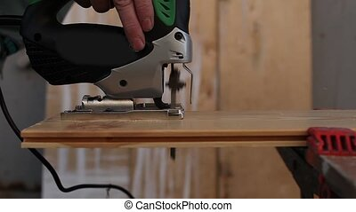 sawing jigsaw - Electric jigsaw to Cut wooden board