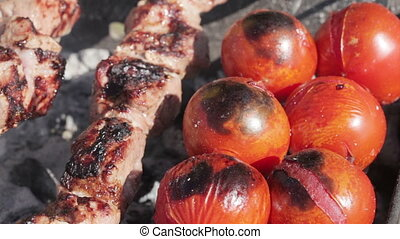 Cooking kebabs - Several mangals with burning coal and...