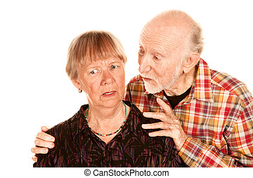 Senior man sharing information with concerned wife -...