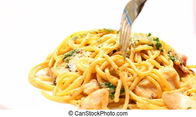 Eating pasta carbona - Close up of eating of pasta carbonara