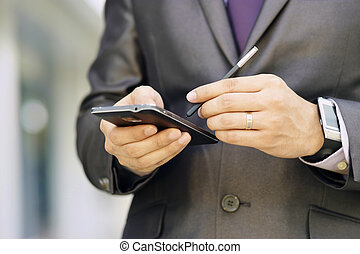 Business Man Typing With Pen On Phablet Smartphone