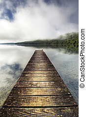 Boat jetty stretching over calm lak