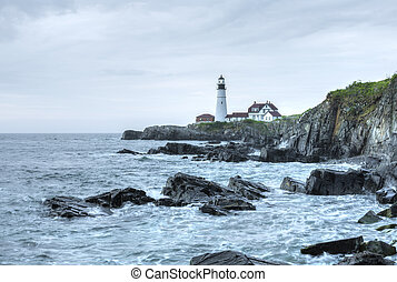 Portland Head Light lighthouse on rugged Maine coast -...