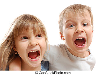 naughty shouting kids - isolated portrait of a boy and girl...