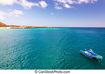 Blue Ocean and Dinghy - Beautiful blue and turquoise ocean...