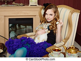 Young girl at the image of Alice in Wonderland - Young girl...