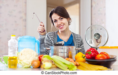 Happy young woman cooking veggie lunch - Happy beautiful...