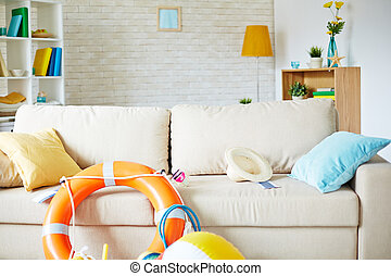 Travel objects - Sofa in empty room with equipment and...