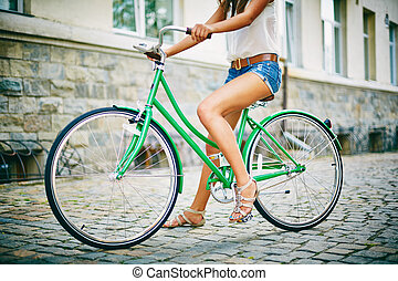 Sitting on bicycle