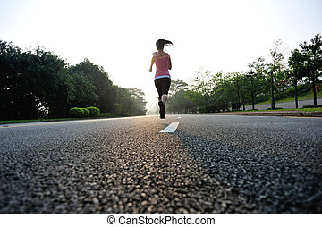 Runner athlete running at road. woman fitness sunrise...