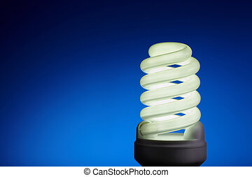 light bulb - energy concept on blue background, selective...