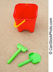 Toys beach in the sand -bucket, shovel and rake-