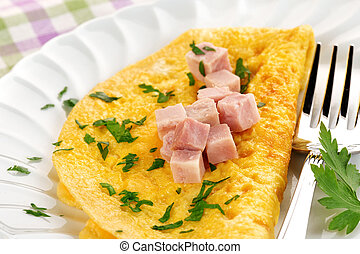 ham omelet - omelette garnished with diced ham and parsley