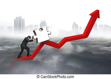 Business man pushing 3D jigsaw puzzle upward red trend line...