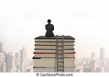 Businessman sitting on stack of books with wooden ladder,...