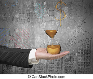 Hourglass in the businessmans hand, with business concepts...