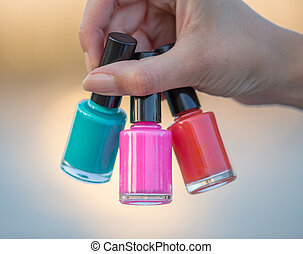 woman hands with nail polishes, close-up
