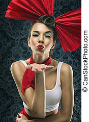 Vintage woman in red dress with big red bow in head