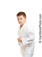 Karate boy with clenched fists