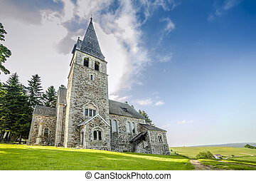 Stone church after storm, before sunset in vivid colors