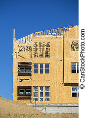 Big house under construction - Big multifamily housing under...