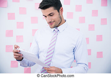 Happy businessman reading document - Happy businessman...