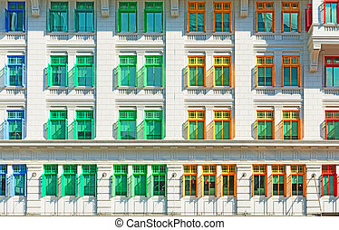 Many-coloured  windows in old vintage classical building
