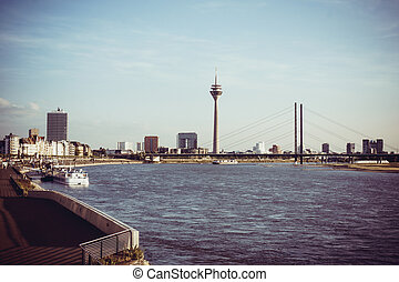 Duesseldorf skyline with Rheinturm and river