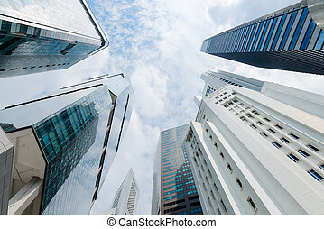 Modern Highrise Buildings Stretch Skyward on a Partly Cloudy...