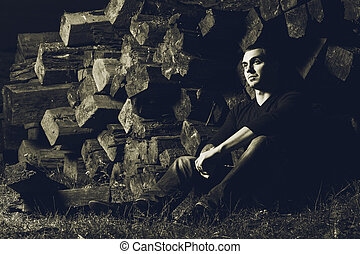 casual young man sitting outdoor - casual young man with...