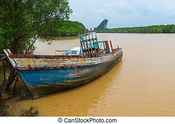 Old Wooden Boat, Abandoned and Deteriorating on a Muddy...