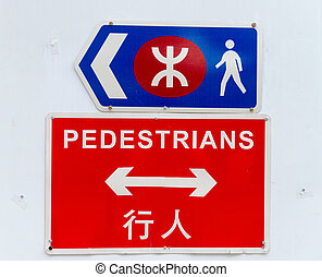Brightly colored signs direct pedestrians safely and closed...