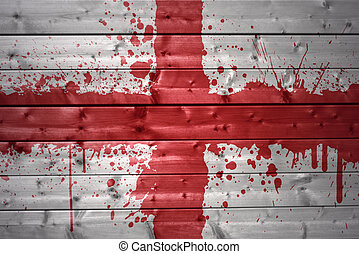 painted english flag on a wooden texture