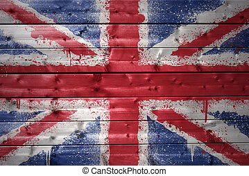 painted british flag on a wooden texture