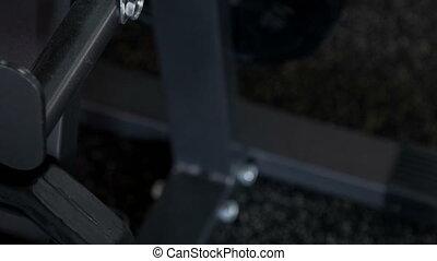 Sport iron equipment is standing on floor - Grey barbell is...