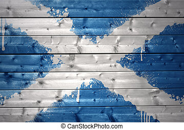 painted scottish flag on a wooden texture