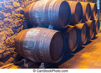 cellar with wine barrels - cellar with row of traditional...