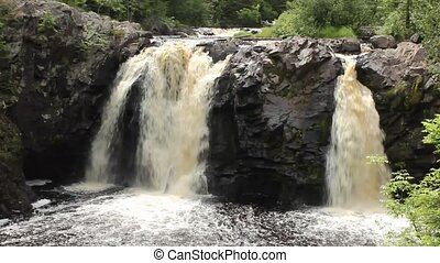 double waterfalls - Two waterfalls on a wild river in the...